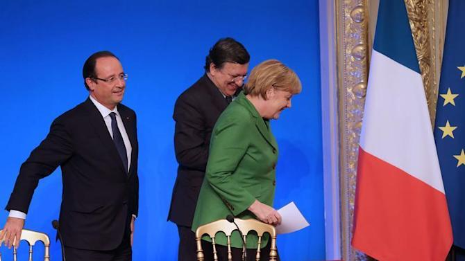 French President Hollande, German Chancellor Merkel, European Commission President Barroso attend a news conference at the end of an international summit on youth unemployment at the Elysee Palace in Paris