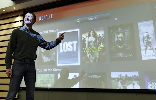 In this March 20, 2012, photo, Netflix Chief Product Officer Neil Hunt points out popular movies on Netflix at a theater inside Netflix headquarters in Los Gatos, Calif. A big part of Netflixs future rides on how much their engineers can improve the software that draws up lists of TV shows and movies that might appeal to each of the video-subscription services 26 million customers. Netflix has spent 13 years learning viewers disparate tastes so it can point out movies they might enjoy. (AP Photo/Paul Sakuma)