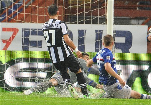 Juventus' Fabio Quagliarella scores first goal during a Serie A soccer match between Sampdoria and Juventus at the Genoa Luigi Ferraris stadium, Italy, Saturday, May 18, 2013