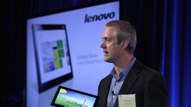 Tom Butler, Director of Lenovo ThinkPad Marketing, speaks while holding a Lenovo tablet Thursday, Sept. 27, 2012, in San Francisco. Intel previewed a wave of tablet computers powered by a microprocessor that the company redesigned to make a bigger dent in the rapidly growing mobile market. An assortment of major computer vendor made the tablets previewed Thursday in San Francisco. All the devices depend on Intel Corp.'s new processor and Windows 8, a dramatic overhaul of the widely used operating system made by Microsoft Corp. (AP Photo/Ben Margot)