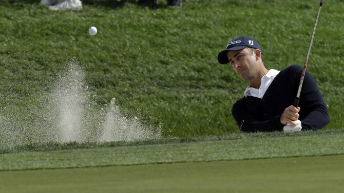 Geoff Ogilvy, from Australia, hits from the trap on the sixth hole during the third round of the Honda Classic golf tournament in Palm Beach Gardens, Fla., Saturday, March 2, 2013. (AP Photo/J Pat Carter)