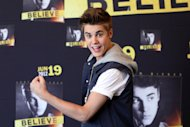 Pop star Justin Bieber poses for photos prior to a press conference at a hotel in Mexico City, Monday, June 11, 2012. Bieber will perform in a free open-air concert tonight at the Mexico City&#39;s main historic plaza, the Zocalo. (AP Photo/Alexandre Meneghini)