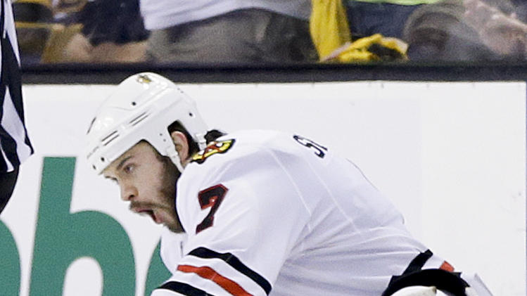 Chicago Blackhawks defenseman Brent Seabrook (7) celebrates his game-winning goal against the Boston Bruins during the first overtime period in Game 4 of the NHL hockey Stanley Cup Finals, Wednesday, June 19, 2013, in Boston. Chicago won 6-5. (AP Photo/Elise Amendola)