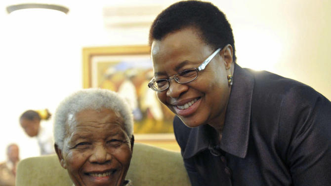 FILE  This May 16, 2011 file photo supplied by the South African Government Communications and Information Services, GCIS, shows former South African President Nelson Mandela and his wife Graca Machel after they cast an early ballot in upcoming local elections at his home in Johannesburg, South Africa. South Africa's president has visited former leader Nelson Mandela in a hospital, and the presidency says Mandela continues to respond to treatment. The office of President Jacob Zuma says he saw Mandela on Saturday, Dec. 22, 2012,  in Pretoria, the capital, and assured the anti-apartheid icon that he has the support of all South Africans and the world. Mandela, who is 94, has been hospitalized since Dec. 8. He was diagnosed with a lung infection and also had gallstone surgery. (AP Photo/Elmond Jiyane-GCIS, File)