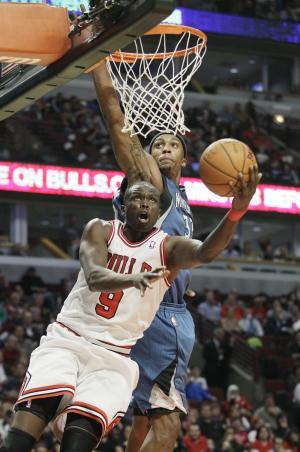 Chicago Bulls forward Luol Deng 99), of South Sudan, drives to the basket past Minnesota Timberwolves forward Dante Cunningham (33) during the second half of an NBA preseason basketball game in Chicago, Friday, Oct. 19, 2012. The Bulls won 92-81. (AP Photo/Nam Y. Huh)