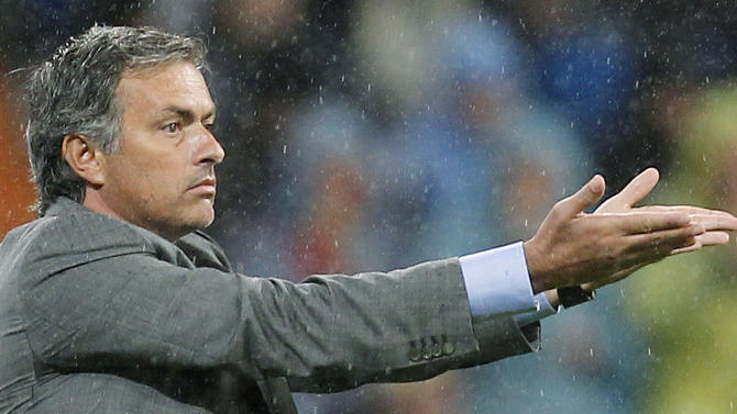 Real Madrid's coach Jose Mourinho from Portugal reacts during a Spanish La Liga soccer match against Deportivo la Coruna at the Santiago Bernabeu stadium in Madrid Sunday Oct. 3, 2010. Real Madrid won the match 6-1. (AP Photo/Paul White)