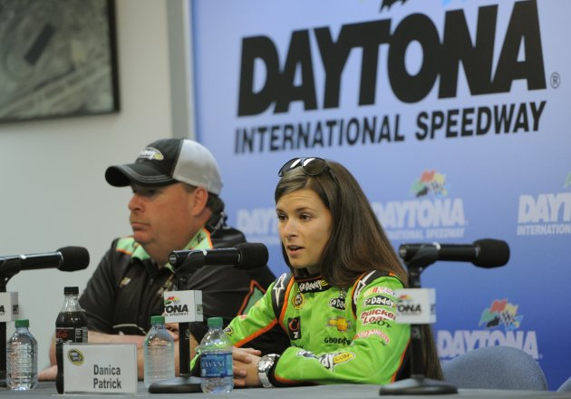 Danica Patrick speaks at a media conference with her crew chief Gibson after her NASCAR Sprint Cup Series practice at the Daytona International Speedway