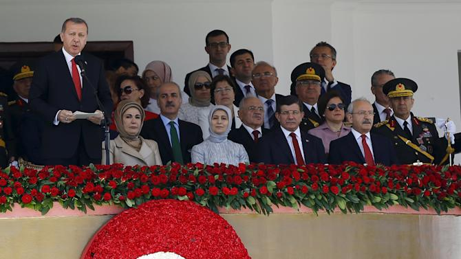 Turkey's President Tayyip Erdogan delivers a speech during a parade marking the 93rd anniversary of Victory Day in Ankara
