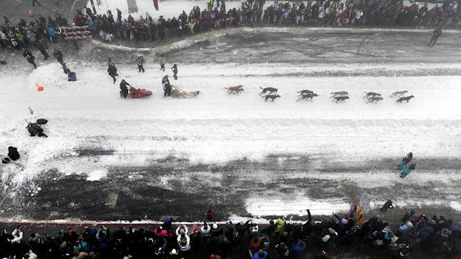 Four-time Iditarod champion Jeff King drives his dog team down 4th Avenue during the ceremonial start of the Iditarod Trail Sled Dog Race on Saturday, March 2, 2013, in Anchorage, Alaska. The competitive portion of the 1,000-mile race is scheduled to begin Sunday in Willow, Alaska. (AP Photo/Anchorage Daily News, Bill Roth)