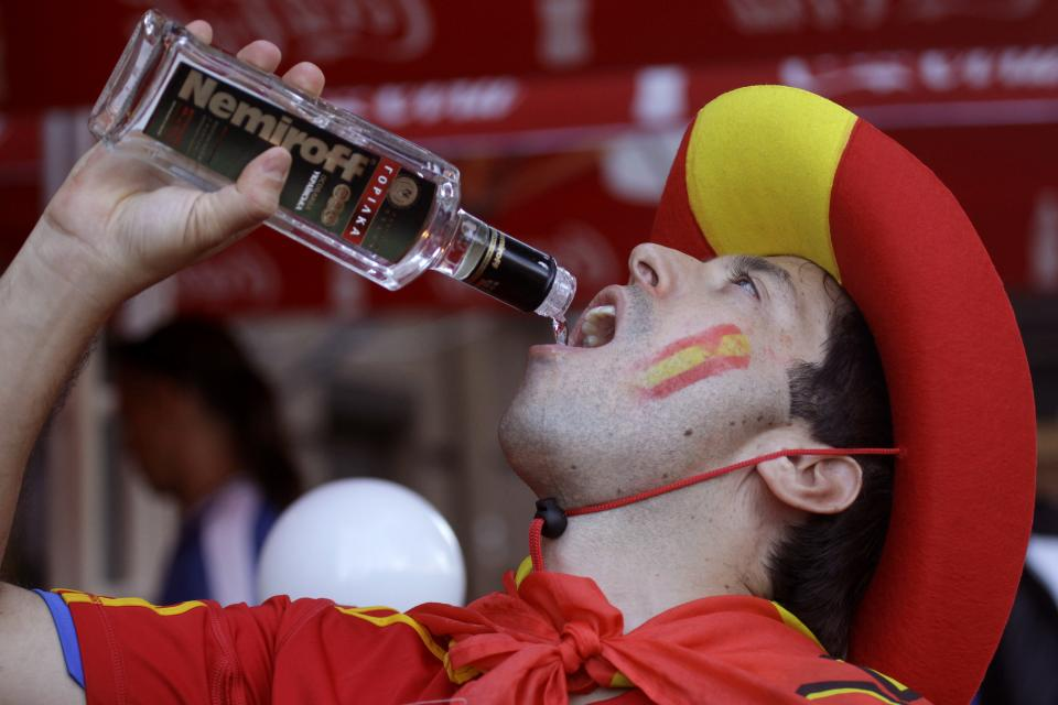 A Spain supporter drinks vodka ahead of the Euro 2012 soccer championship final match between Spain and Italy in Kiev, Ukraine, Sunday, July 1, 2012.(AP Photo/Efrem Lukatsky)