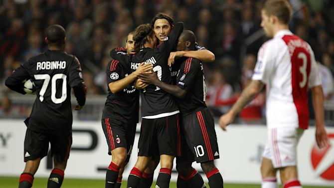 Zlatan Ibrahimovic of AC Milan, center, celebrates his goal against Ajax with teammates during the first round group G Champions League soccer match at the Arena stadium in Amsterdam, The Netherlands, Tuesday Sept. 28, 2010. (AP Photo/Bas Czerwinski)
