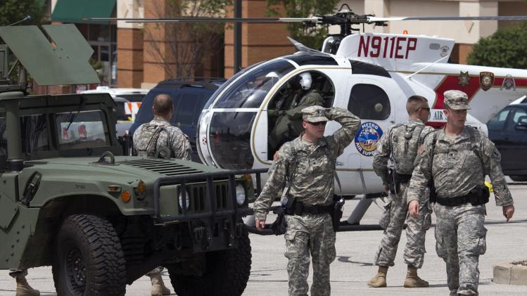 National Guard troops walk through a staging area inside a shopping center parking lot in Ferguson, Missouri