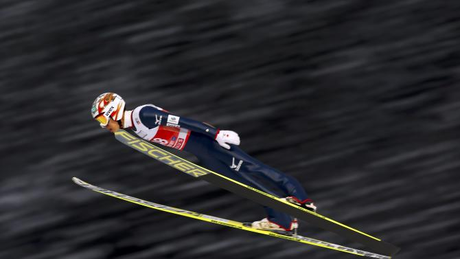 Taku Takeuchi from Japan soars through the air during the trial round for the first jumping of the 63rd four-hills ski jumping tournament in Oberstdorf