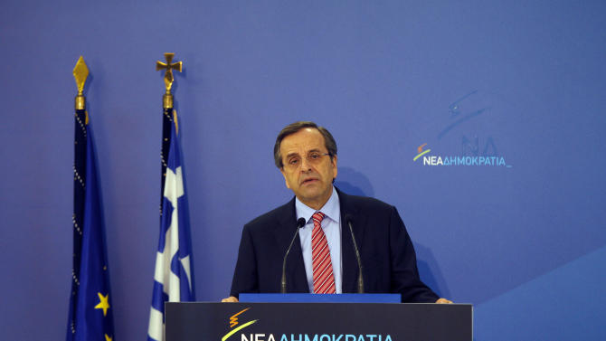 "Greek Prime Minister Antonis Samaras speaks to his parliamentary group of lawmakers about the upcoming vote on the new round of austerity measures next week, at the headquarters  of conservative ""New Democracy"" party, in Athens, Sun. Nov. 4 2012. Greece's coalition government is struggling to push through a new round of austerity measures that is set to impose new wage, pension, and benefit cuts on a public already plagued by 25 percent unemployment. (AP Photo/Kostas Tsironis)"