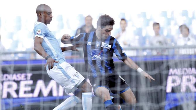 Atalanta midfielder Giacomo Bonaventura, right, is challenged by Lazio defender Abdoulay Konko, of France, during a Serie A soccer match between Lazio and Atalanta, at Rome's Olympic stadium, Sunday, March 9, 2014