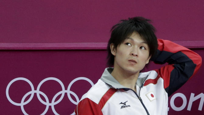 Japanese gymnast Kohei Uchimura reacts in dejection after the initial result declaration where his team figured fourth place, during the Artistic Gymnastic men's team final at the 2012 Summer Olympics, Monday, July 30, 2012, in London. After judges spent about five minutes reviewing three-time world champion Uchimura on the pommel horse, his score was revised and Japan was awarded the silver medal with Britain getting bumped down to bronze. (AP Photo/Matt Dunham)