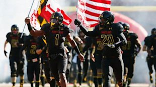 Maryland Terrapins run onto the field before a game. (Getty)