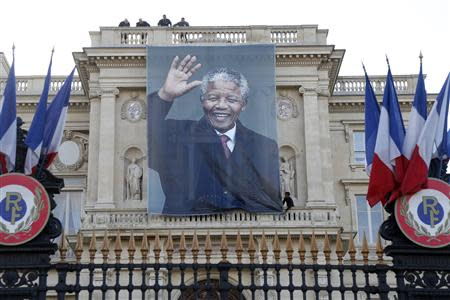 A giant banner with a photo of the late South African President Mandela covers the facade of the Quai d'Orsay Foreign Affairs Ministry in Paris