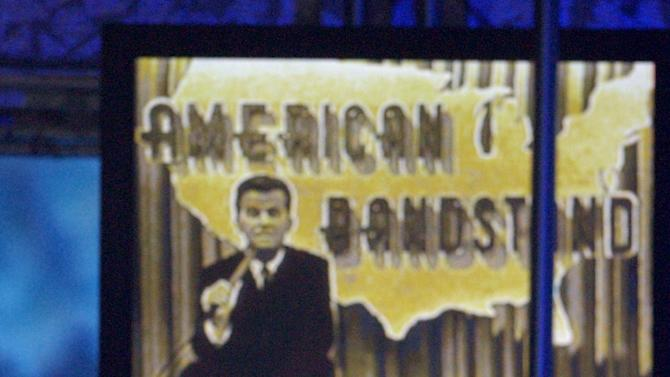 """FILE - In this April 20, 2002 file photo, Dick Clark, host of the American Bandstand television show, introduces entertainer Michael Jackson on stage during taping of the show's 50th anniversary special in Pasadena, Calif. Clark, the television host who helped bring rock `n' roll into the mainstream on """"American Bandstand,"""" died Wednesday, April 18, 2012 of a heart attack. He was 82. (AP Photo/Kevork Djansezian, File)"""