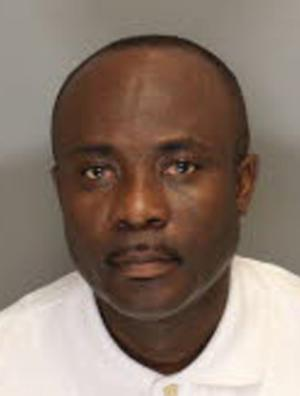 This undated booking photo provided by the Cobb County Sheriff in Marietta, Ga., shows Ernest Addo, 48, who was arrested on Aug. 24, 2012 for identity theft and practicing medicine without a license. When Addo's friend went to Africa for a year, he assumed his buddy's identity, all the way down to the man's medical license. Authorities said Addo saw up to 500 patients at five senior homes in Columbia, S.C., before he was discovered. (AP Photo/Cobb County Sheriff)