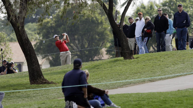 Michael Thompson hits from the fifth fairway back onto the sixth fairway during the third round of the Honda Classic golf tournament in Palm Beach Gardens, Fla., Saturday, March 2, 2013. (AP Photo/J Pat Carter)