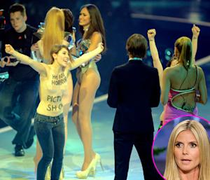 Heidi Klum Ambushed by Topless Protestors on Germany's Next Top Model