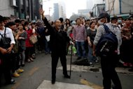 &lt;p&gt;A demonstrator protests in Ningbo, east China&#39;s Zhejiang province, on Sunday, against a proposed 55.9 bln yuan ($8.9 bln) chemical plant.&lt;/p&gt;