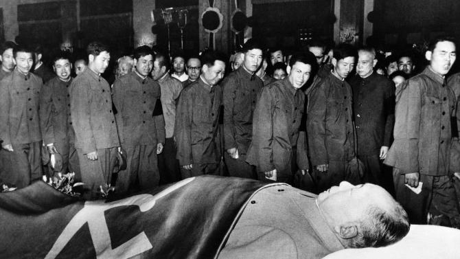 FILE - In this undated photo, commanders and fighters of the Chinese People's Liberation Army pay their respects to the body Mao Zedong in China. The man commonly known as Chairman Mao is one of several world leaders whose bodies have been preserved and put on perpetual display, as Venezuela's government plans to do with Hugo Chavez. (AP File Photo)
