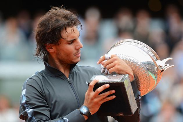 Rafael Nadal Of Spain Poses With The Coupe Des Mousquetaires Trophy In The Men's Singles Final Against Novak Djokovic Getty Images