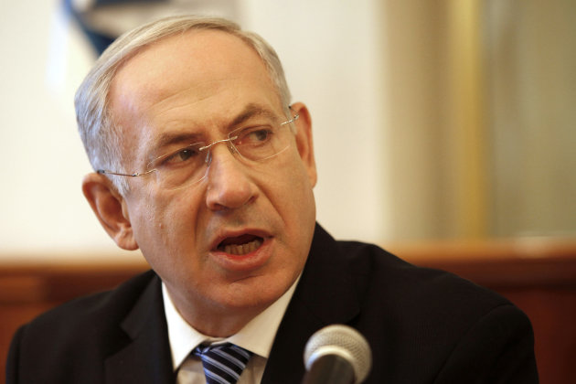Israeli Prime Minister Benjamin Netanyahu opens the weekly cabinet meeting at his office in Jerusalem, Sunday, July 22, 2012. The Israeli government is asking the countrys Supreme Court to delay the evacuation of an unauthorized West Bank settlement outpost by a month. The court has ordered the Migron outpost dismantled by Aug. 1, 2012. (AP Photo/Gali Tbbon, Pool)
