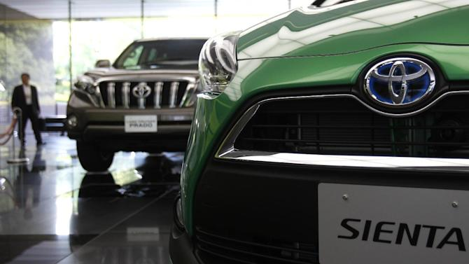 Cars are displayed at the showroom of the Toyota Motor Corp. headquarters in Tokyo, Tuesday, Aug. 4, 2015. Toyota's profit for April-June rose 10 percent on perks from a cheap yen and cost reduction efforts that offset lower vehicle sales. Toyota Motor Corp. had a fiscal first quarter profit of 646.3 billion yen ($5.2 billion), up from $587.7 billion a year earlier. (AP Photo/Ken Aragaki)