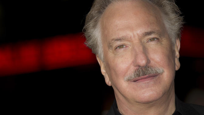 Alan Rickman arrives for the World Premiere of Gambit at the Empire cinema in central London, Wednesday, Nov. 7, 2012. (Photo by Joel Ryan/Invision/AP)