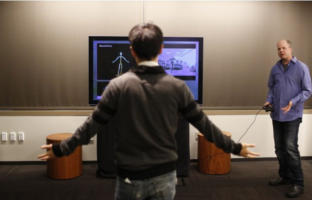Kinect Group Program Manager Evans shows a guest the newest generation Kinect sensor for the Xbox One during in Redmond