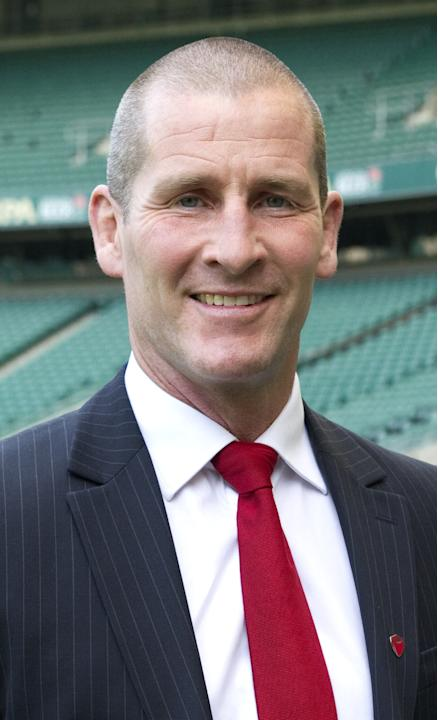 Stuart Lancaster, the new head coach of England's rugby union team poses for photographers before a press conference in Twickenham stadium in south west London on March 29, 2012. Lancaster has been co