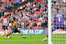Hull City's Ivory Coast striker Yannick Sagbo (C) scores his team's first goal during the English FA Cup Semi-final match between Hull City and Sheffield United at Wembley Stadium in London on April 13, 2014