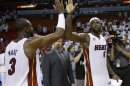 Miami Heat small forward LeBron James (6) is congratulated by Dwyane Wade (3) after defeated the Indiana Pacers in Game 1 in their NBA basketball Eastern Conference finals playoff series, Wednesday, May 22, 2013 in Miami. The Heat won 103-102 in overtime. (AP Photo/Lynne Sladky)