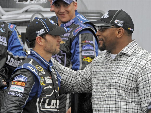 Driver Jimmie Johnson (L) celebrates in victory lane with NFL player Ray Lewis (R) after winning the NASCAR Sprint Cup Series Daytona 500 race at the Daytona International Speedway in Daytona Beach