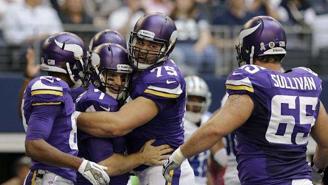 Minnesota Vikings' Jerome Simpson, left, John Sullivan (65) and Matt Kalil (75) celebrate the touchdown run by Christian Ponder, second from left, in the first half of an NFL football game against the Dallas Cowboys, Sunday, Nov. 3, 2013, in Arlington, Texas. (AP Photo/Nam Y. Huh)