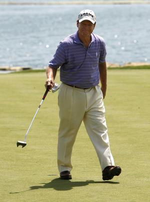Tom Watson smiles to the crowd after sinking a birdie putt on the seventh hole during the final round of the Senior PGA Championship golf tournament at Valhalla Golf Club in Louisville, Ky., Sunday, May 29, 2011.  (AP Photo/Ed Reinke)