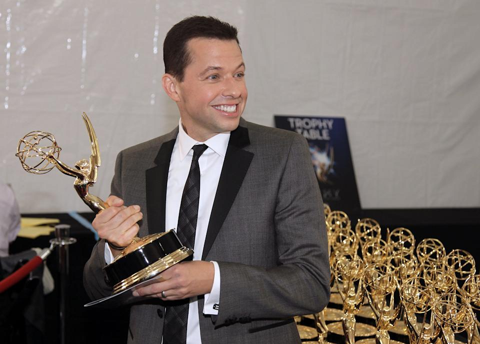 Actor Jon Cryer, winner of Outstanding Lead Actor in a Comedy Series, poses backstage at the 64th Primetime Emmy Awards at the Nokia Theatre on Sunday, Sept. 23, 2012, in Los Angeles. (Photo by Matt Sayles/Invision/AP)