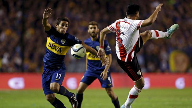 Boca Juniors' Meli and River Plate's Rojas fight for the ball during their Argentine First Division soccer match against River Plate in Buenos Aires