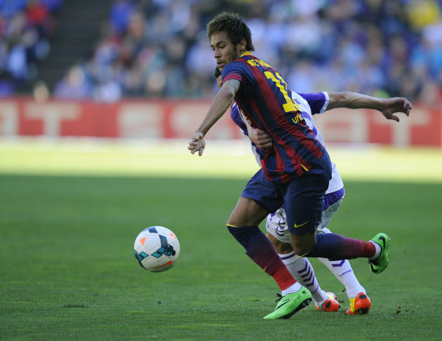 Barcelona's Neymar from Brazil struggle for the ball during a Spanish La Liga soccer match at the Jose Zorrilla stadium in Valladolid, Spain, Saturday March 8, 2014