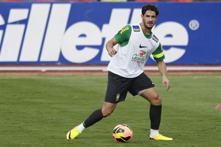 Brazilian national soccer team player Pato kicks the ball during a training session in Brasilia