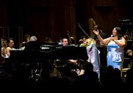 Aretha Franklin (right) and Condoleezza Rice (left) perform with the Philadelphia Orchestra at the Mann Center for Performing Arts in Philadelphia on July 27, 2010. Philadelphia's renowned orchestra has officially emerged from bankruptcy, in part thanks to a visit to China, and now looks forward to an unexpectedly bright future, the CEO said Tuesday