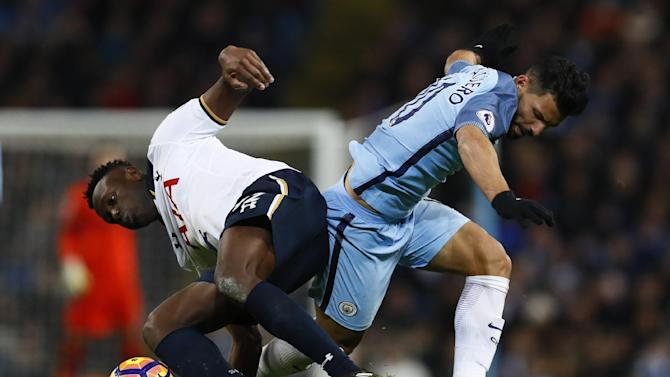 Manchester City's Sergio Aguero in action with Tottenham's Victor Wanyama