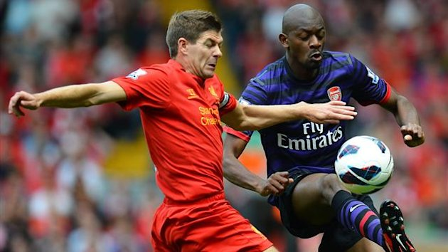 Liverpool's English midfielder Steven Gerrard (L) vies with Arsenal's French midfielder Abou Diaby during the English Premier League football match between Liverpool and Arsenal at Anfield (AFP)