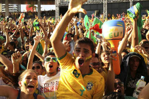 Brazilian fans celebrate after Brazil scored against Croatia during their 2014 World Cup opening match, at a FIFA event in Manaus