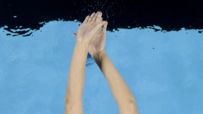 China's Zhao Jing stars her race in a heat of the women's 100m Backstroke at the FINA Swimming World Championships in Shanghai, China, Monday, July 25, 2011. (AP Photo/Gero Breloer)