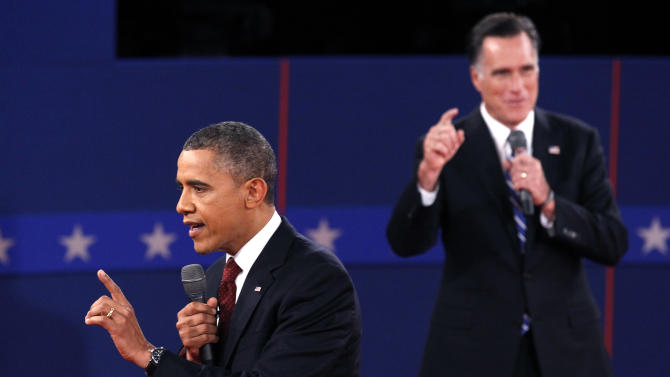 U.S. Republican presidential nominee Romney and U.S. President Obama speak at the same time during the second U.S. presidential campaign debate in Hempstead