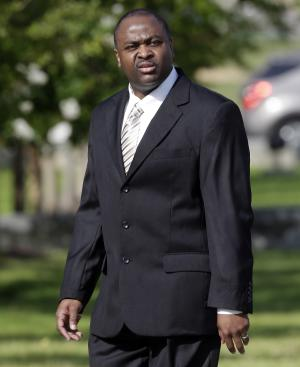 Former Ventress Correctional Facility Lt. Michael Smith arrives at the Federal Building in Montgomery, Ala., Tuesday, June 25, 2013. A federal court jury will begin deliberations Tuesday in the trial of the former prison supervisor who is charged with fatally beating an inmate and trying to cover up what happened. Smith is charged with violating the constitutional rights of inmate Rocrast Mack, obstruction of justice and conspiracy.(AP Photo/Dave Martin)